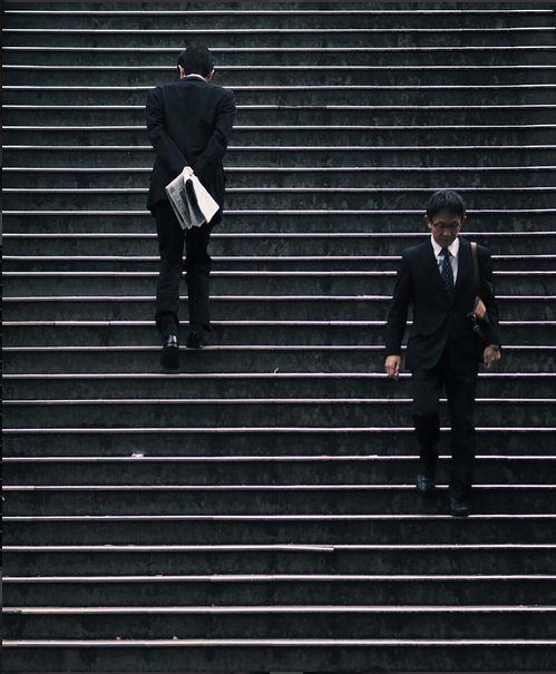 man on stairs taku